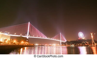 The Bai Chay Bridge in Ha Long, Vietnam lit up with colorful lighting at night