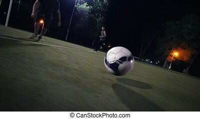 The ball moves on the field, it is a football player, makes the transfer to another player who scores it into the goal