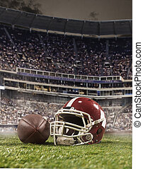 The ball of american football players and helmet on stadium background