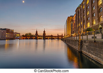The banks of the river Spree in Berlin with the Oberbaum...