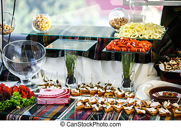 The banquet table with  snacks