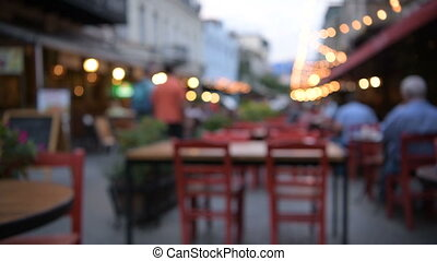 The Bar or cafe on the Street outdoors at Night in the City...