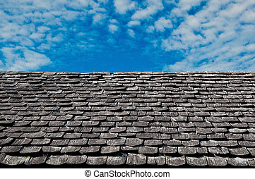 The Bark tiles of roof on blue sky background