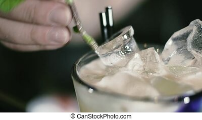 The barman is preparing a cocktail in the night club bar 4k...