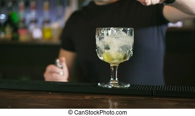 The barman is preparing a cocktail in the night club bar 4k