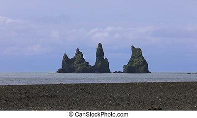 The basalt sea stacks Reynisdrangar. Vik, Iceland. - The...