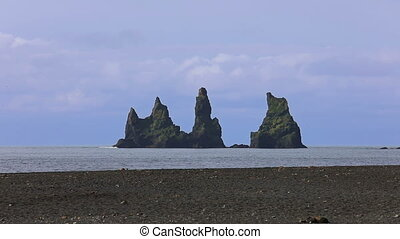 The basalt sea stacks Reynisdrangar. Vik, Iceland. - The...