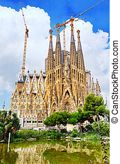 The Basilica of La Sagrada Familia against blue...