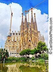 The Basilica of La Sagrada Familia against blue...