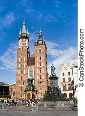 The basilica of the Virgin Mary and Adam Mickiewicz Statue