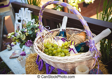 basket with wine and fruit