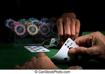 The battle in card games of blackjack at a casino with chips...