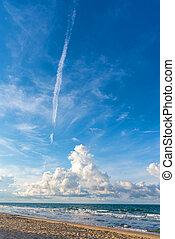 the beach and blue sky on sunny day .