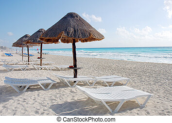 The beach by the Carribean sea in Cancun Mexico