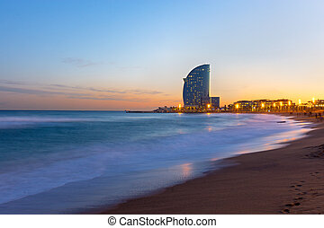 The beach of Barcelona at sunset