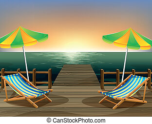 The beach umbrellas and the foldable chairs at the bridge -...