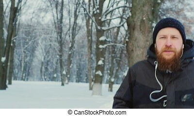 The bearded man on a morning jog in the winter