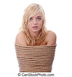 The beautiful blond girl tied with rope - kidnapping concept