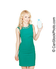 beautiful blonde holds in a hand a bottle cosmetics