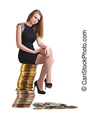 The beautiful blonde sits on a column of coins