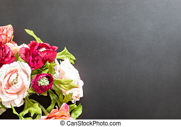The beautiful bouquet on black background with a copy-space