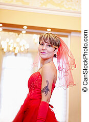 The beautiful bride in a red dress