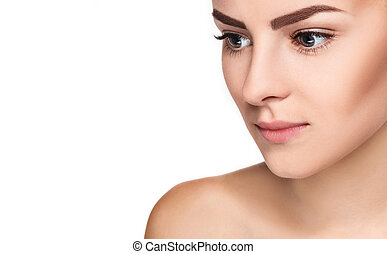 The beautiful face of young woman with clean fresh skin