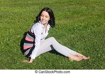 on a green grass