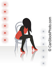 The beautiful girl in a red dress sits on a chair