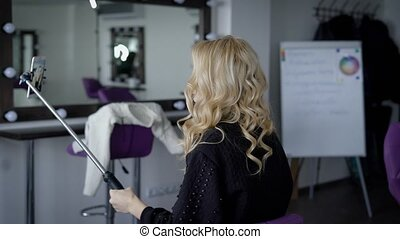 The beautiful girl in beauty shop. The blonde is ready to a...
