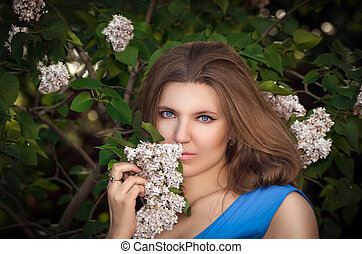 The beautiful girl in the forest with a lilac
