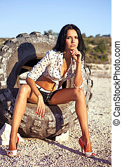 beautiful girl poses on a tire - the beautiful girl poses on...