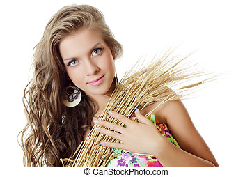 The beautiful girl with wheat ears