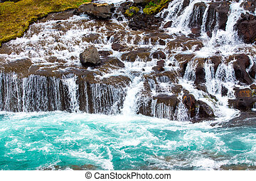 The beautiful Hraunfossar falls