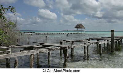 the beautiful lake bacalar, with crystal clear blue water,...