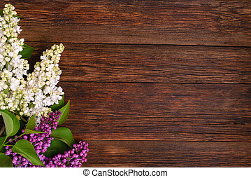 The beautiful lilac on a wooden background
