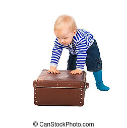 little child with a suitcase isolated on a white background
