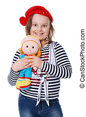 The beautiful little girl with a rag doll