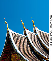 The Beautiful roof of temple on blue sky background