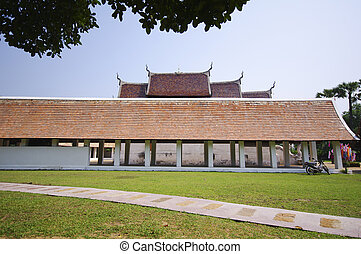 The Beautiful roof of temple on blue sky background with green g