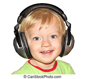 small child listens to music in the headphones isolated on a whi