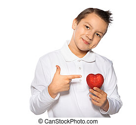 teenager with a heart in hands smiles