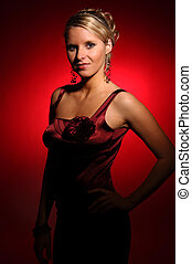 The beautiful woman in the satin red dress.