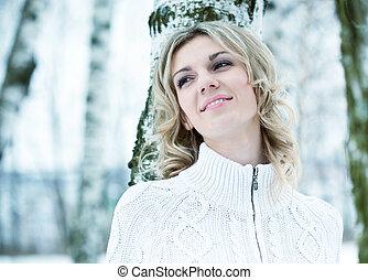 The beautiful woman in winter wood