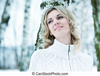 The beautiful woman in winter wood