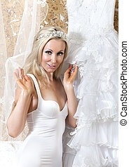 woman with a wedding dress. Fitting