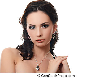 The beautiful woman with expensive jewelry - The beautiful...