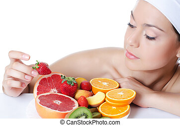 The beautiful woman with fruit
