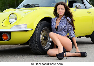 The beautiful woman with yellow car