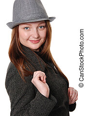 The beautiful young girl in a hat